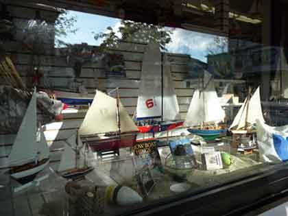 Shop window showing model sailboats