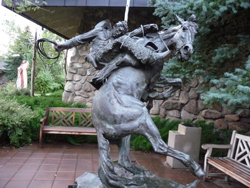 Sculpture of cowboy riding bucking horse