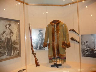 Buffalo Hide Coat and Rifle