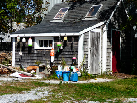 Lobster floats on side of shed.