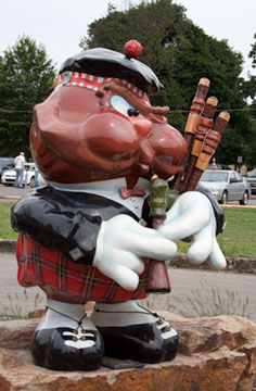Statue of Punxsutaweny Phil playing bagpipe