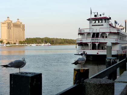 Tour boat with hotel in background Savannah waterfront